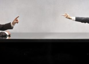 11571332 - two businessmen sitting at a table and quarreling